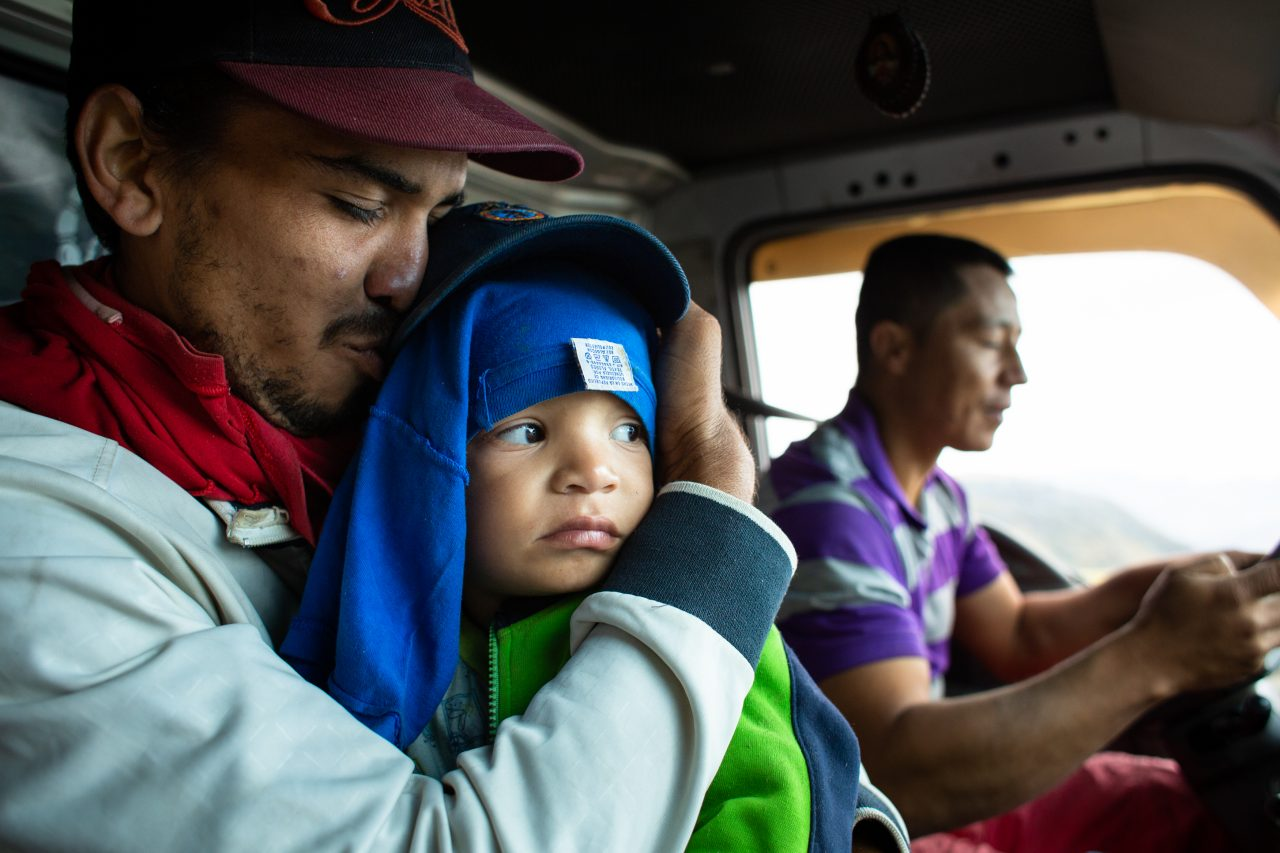Juan, 28, kisses his son Santiago, after a truck offered them to take them to Bucaramanga. Norte de Santander, Colombia. Nov. 12, 2018. ©Erika Piñeros    **Note: Not for commercial use. Editorial use only. No Book Sales. Mandatory credit/byline. Not for sale for marketing or advertising campaigns. Image to be distributed exactly as supplied. No archive. All rights and copyright retained by photographer. No Syndication. No third-party distribution. Photo to be used only with the original story.